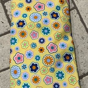 100 % silk tie.  Upbeat, fun colors